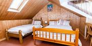A bedroom with a double bed and a single bed at Sunnyside Holiday Apartments in East Yorkshire.