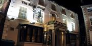 A night view, with lighting, of the entrance to Kings Head Hotel in East Yorkshire.