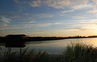 The lake with the sunset at Heron Lakes in East Yorkshire.