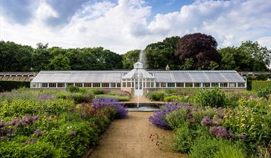 The large greenhouse and gardens at Scampston Hall & Gardens in East Yorkshire.