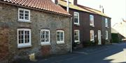 An image of the cottage front at Nordham Cottages