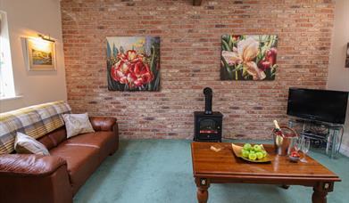 The  living room including log burner at Drewton cottages in East Yorkshire.