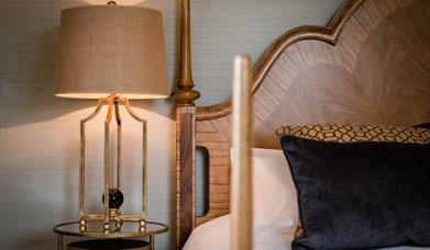 An image of a bedside table and lamp at Saltmarshe Hall.