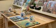 The matching sets with an image on a placemat, coaster and mug at the Robert Fuller Gallery , in East Yorkshire