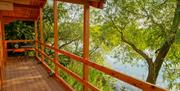 The balcony of a cabin at Kingfisher Lakes Glamping & Lodges, Brandesburton, East Yorkshire.