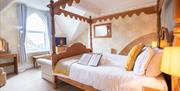 A double bedroom with four poster bed at Mont Millais in East Yorkshire.