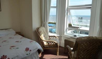 A double room with bay view window overlooking the sea from Beaconsfield House in East Yorkshire.