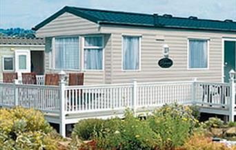 Decking around a caravan at North Bay Leisure in East Yorkshire.