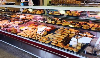 The glass counters full of sausage rolls, pies, scotch eggs and other meat and bakery produce at A Laverack & Son Butchers and Bakers, in East Yorkshi