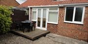 The outside area with seating at Loucindi Cottage in East Yorkshire.