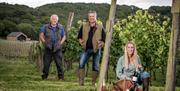 Henry, Tom and Alice, in the vineyards at Little Wold Vineyard, Brough, East Yorkshire, who have won awards for the diversification of their farm.