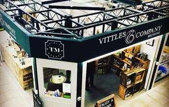 An image taken of the exterior of Vittles & Company shop inside Hulls trinity indoor food hall and market.