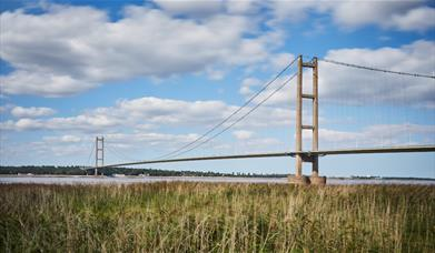 The humber bridge taken from the foreshores looking out across water, in East Yorkshire