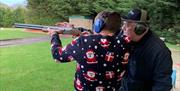 An instructor giving advice to a visitor on clay shooting, in East Yorkshire