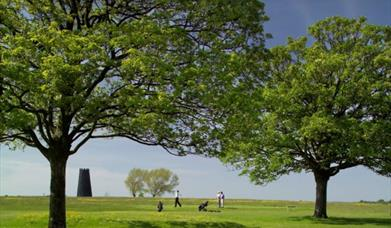 The Black Mill with golfers on the golf course in Beverley, East Yorkshire.