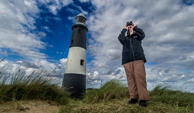 Birdwatching at Spurn Point lighthouse, East Yorkshire