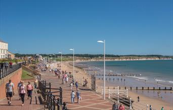 People walking along the promenade and on the North beach at Bridlington in East Yorkshire.