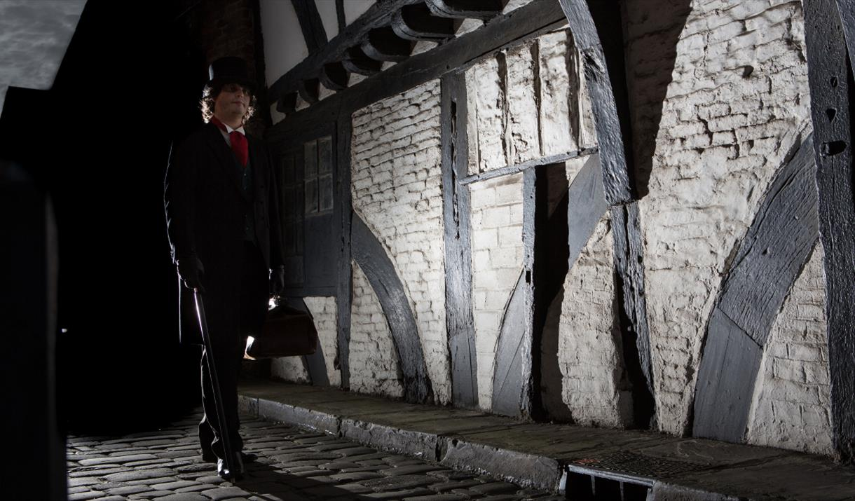 The Ghost Tour guide walking down a spooky looking street in Beverley, in East Yorkshire