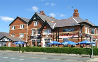 The exterior and seating area at Mon Fort Hotel in East Yorkshire.