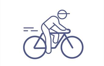 An image of an icon of a cyclist on their bike and riding along