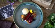 A plate of food dressed with flowers at Tickton Grange in East Yorkshire.