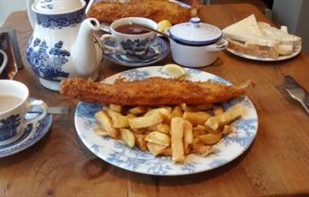 Large portion of fish and chips, with bread and butter and a pot of tea at the Frying Farmer, in East Yorkshire