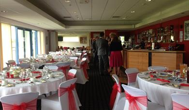 The bar and events area with dressed tables and seating covers ready for a wedding, in East Yorkshire