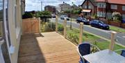The outdoor decked patio area, with seating, at the Expanse apartments in East Yorkshire.