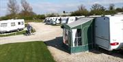 Caravans on pitches at Brenda House Touring Caravan Park in East Yorkshire.