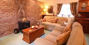 A living room with two, two seater sofas at Drewton cottages in East Yorkshire.