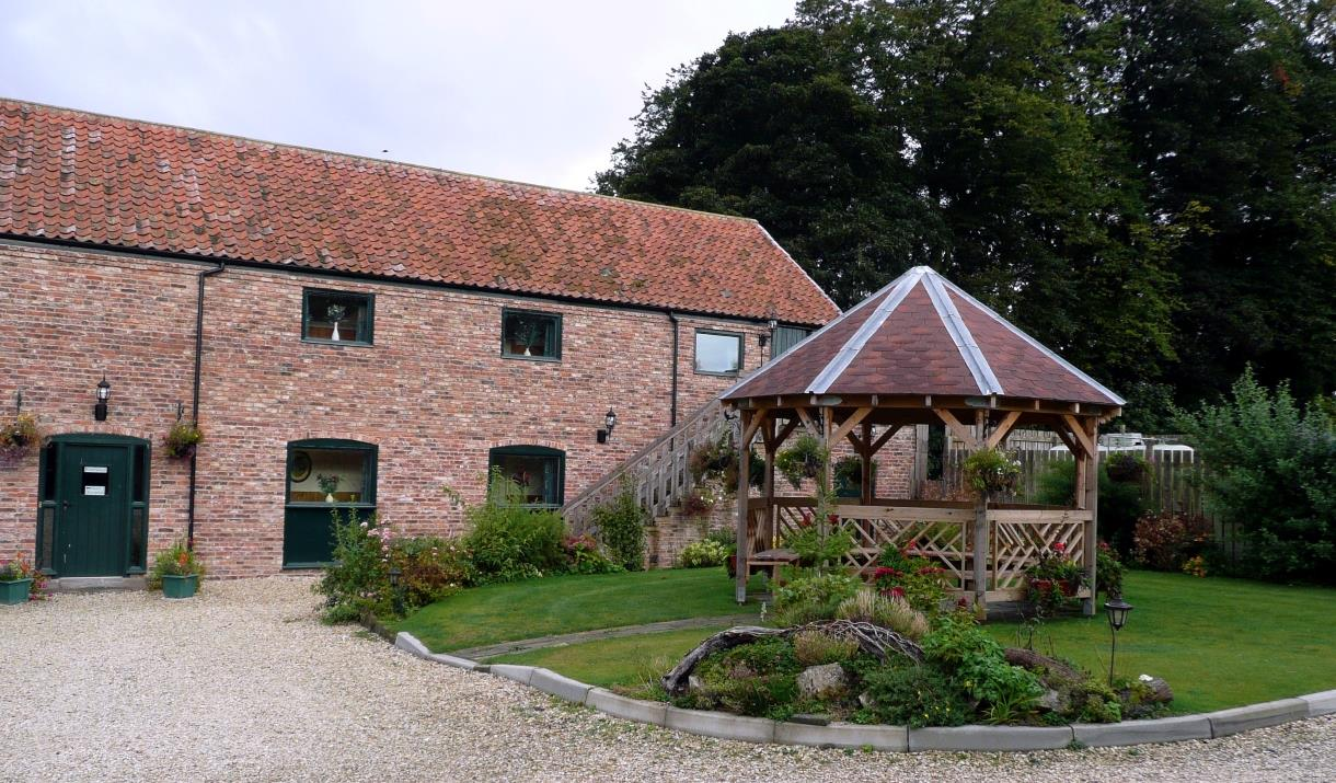 The exterior and seating area at Wolds Village Luxury Guest Accommodation in East Yorkshire.