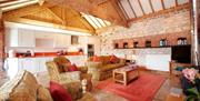 An image of the living area and kitchen in The Roost at Field House Farm Cottages in East Yorkshire.