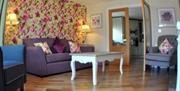 A purple floral living room in the Expanse apartments in East Yorkshire.