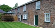 The property exterior and garden area at Laundry Cottage in East Yorkshire.