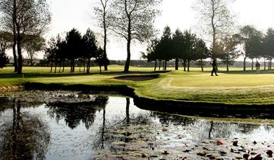 The fairway, trees and pond at Hornsea Golf Club in East Yorkshire.