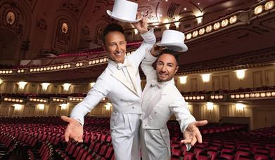 An image of Ian Waite & Vincent Simone, with Hull New Theatre in the background, Hull, East Yorkshire