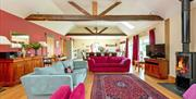 A large cottage living space with log burner and cottage beams, at Broadgate Farm Cottages in East Yorkshire