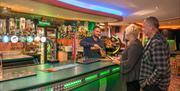 Customers at Makis bar & restaurant at South Cliff Holiday Park, Bridlington, East Yorkshire