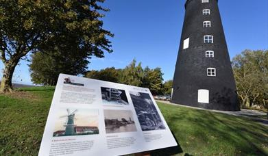 Hessle Mill, newly restored, with information sign at Humber Bridge Country Park, Hessle, East Yorkshire