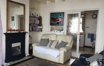 The living area, looking through to the kitchen at Pebble Cottage, Bridlington, East Yorkshire.