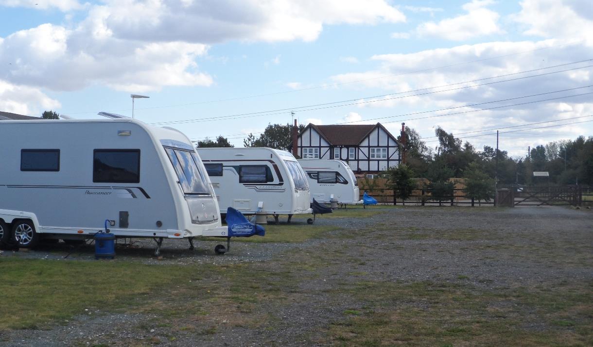 Caravans in a field At Tudor Springs Caravan Site, Beverley in East Yorkshire.