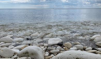 Some stones and pebbles on the beach by the sea in East Yorkshire.