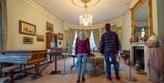 Visitors viewing a room in Sewerby Hall near Bridlington, East Yorkshire
