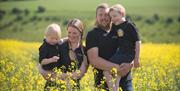 Some of the family standing in a rapeseed field at Yorkshire Rapeseed Oil, Malton, North Yorkshire (Online Shop)