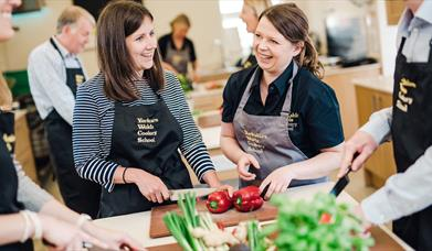 People enjoying a cookery lesson at Yorkshire, Wolds Cookery School, Driffield, East Yorkshire.