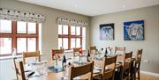 A set table at the Yorkshire Wolds Cookery School, Driffield, East Yorkshire.