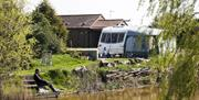 A pitch by the 1 acre lake at Spring Valley Campsite, East Yorkshire