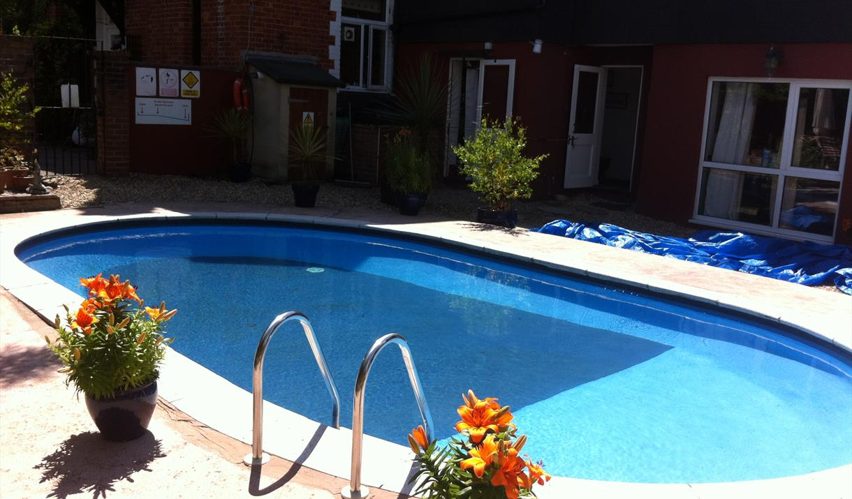 Outdoor swimming pool at The Parks Guest Accommodation, Torquay, Devon