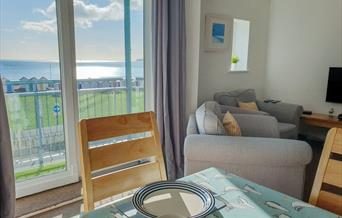 Lounge and view, Penny's Place, 7 Belvedere Court, 37 Marine Drive, Paignton, Devon