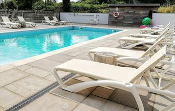 Sun loungers and pool, Blagdon House Country Cottages, Blagdon, Paignton, Devon